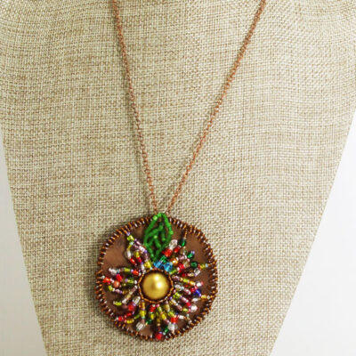 Kaelyn Leather Pinwheel Pendant Necklace close up view