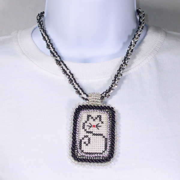 Weeko X-Stitch Cat Bead Pendant Necklace relevant front view
