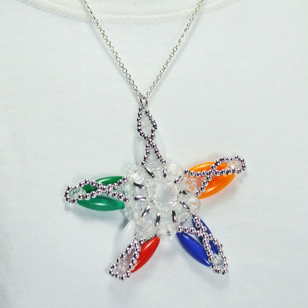 Xarina Beaded OES Star Pendant Necklace close up view