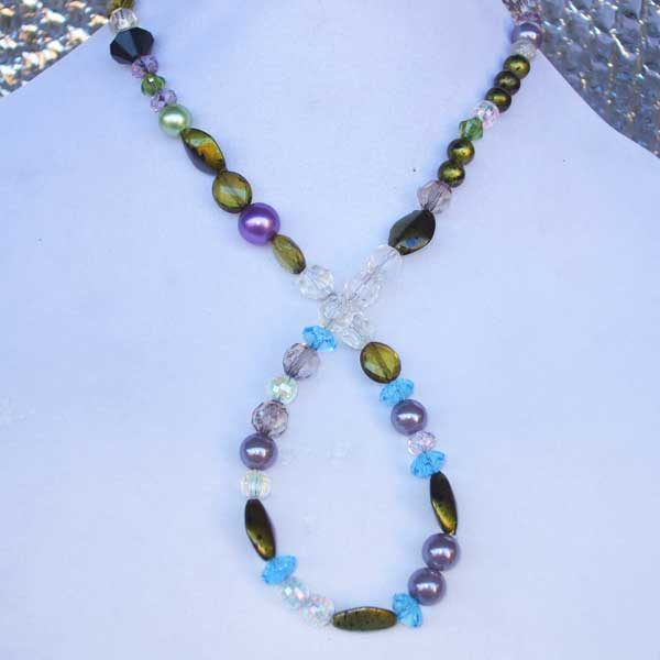 Lee Lee Beauty No 10 - A long strand of beads with primary color of green.